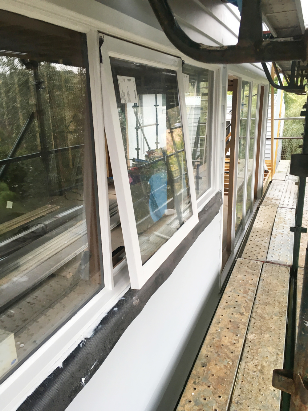 Open windows in between coats of paint to prevent painting the window shut