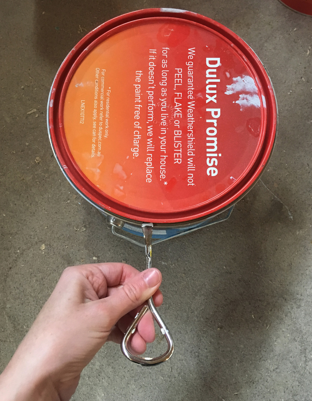Use a can-opener to open the paint can easily