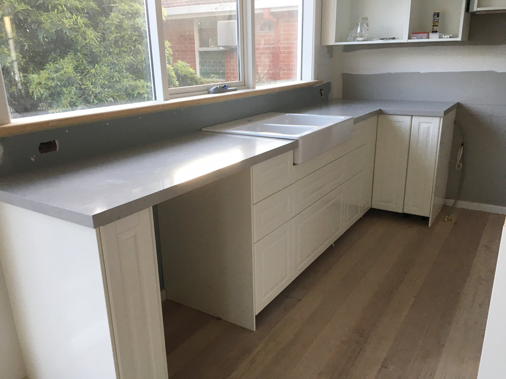 Kitchen bench-tops in grey stone - The Organised You