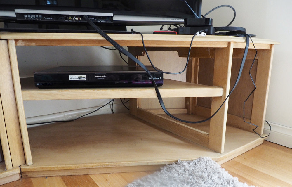 Clearing clutter to gain extra storage space on the TV unit - The Organised You