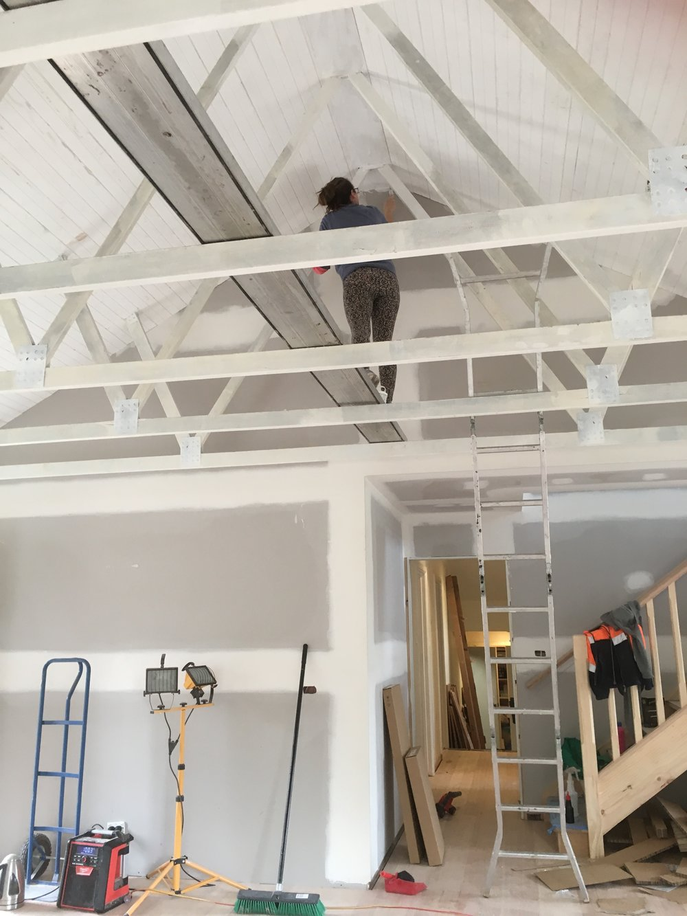 Painting exposed beams for a pitched ceiling