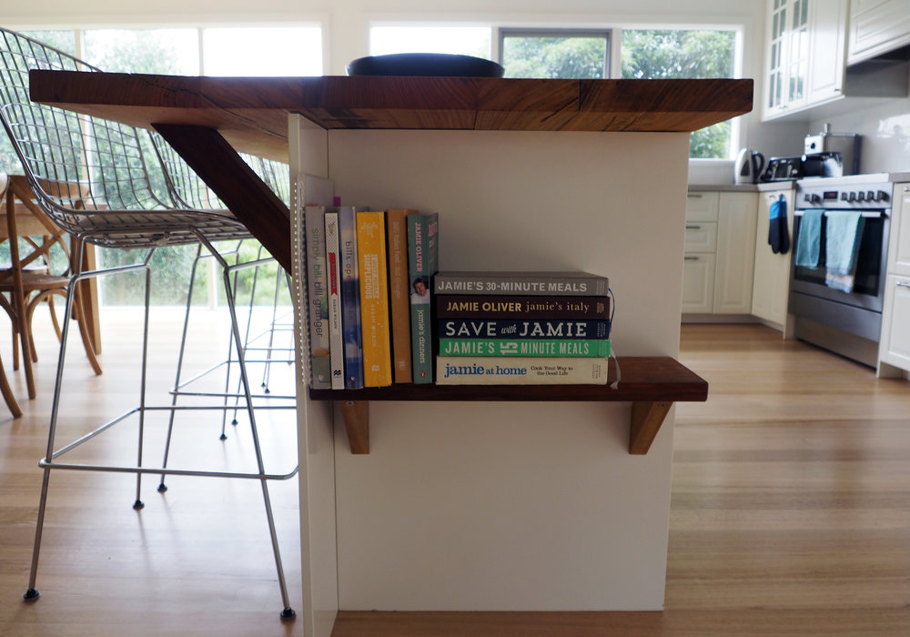 Use the empty space under your island bench as a clever storage solution for recipe books {The Organised You}