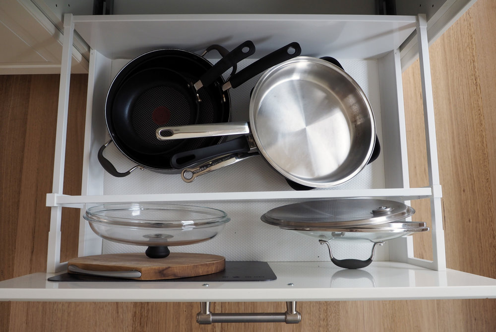 Use large drawer dividers in deep drawers to separate pans and their lids
