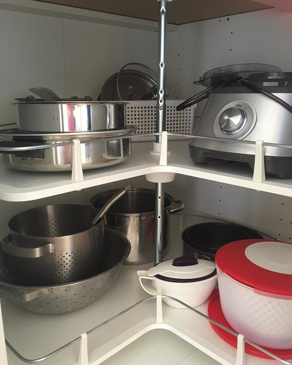 Use a corner cabinet carousel to increase storage and save you time and effort in the kitchen