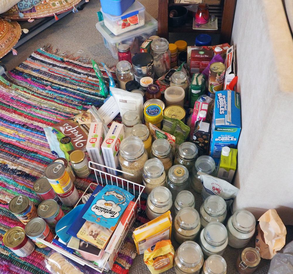 Sorting pantry items into categories to make it easier to declutter and sort