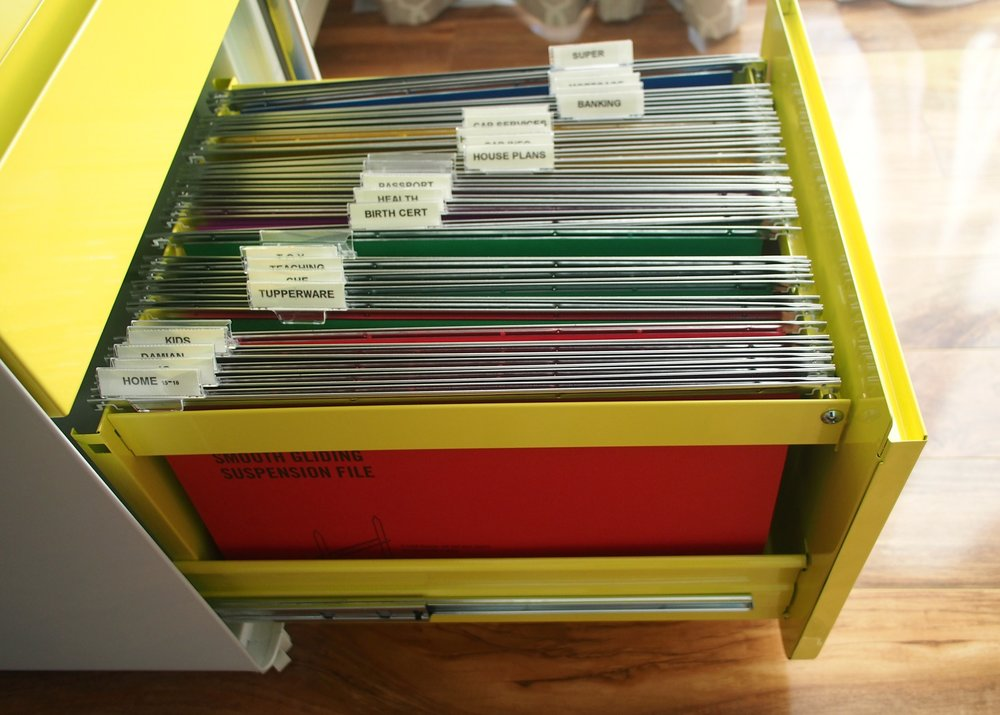 Sort the paperwork you need to keep in a filing cabinet with coloured file folders {The Organised You}