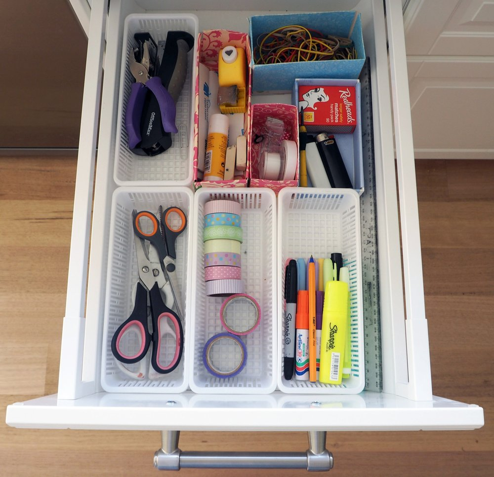 Organise your stationery supplies using small baskets or boxes to make everything accessible and easy to find {The Organised You}