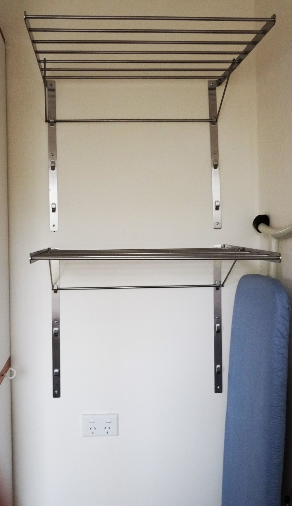 Attach drying racks directly to the wall to save on floor space and make hanging out clothes a breeze!