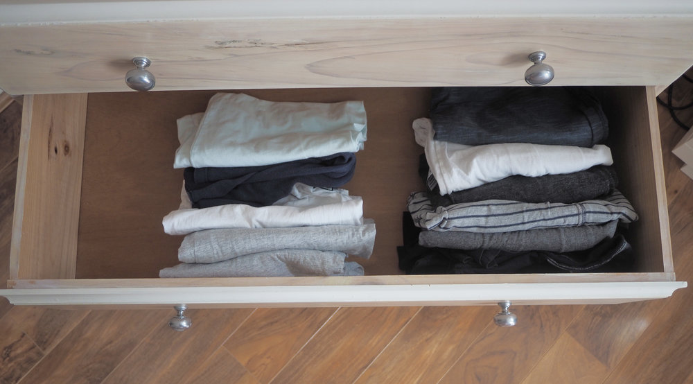 Filing clothes on their side in a drawer will take up less storage space and allow you to see every item of clothing at a glance