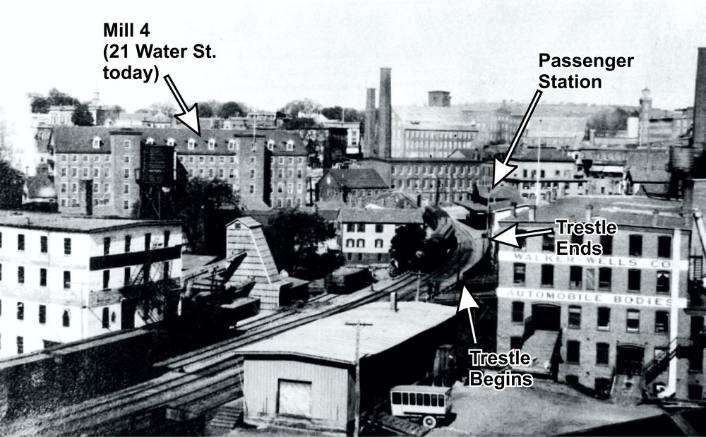 Photo from 1920 looking west from Chestnut Street toward Water Street. A locomotive is on the trestle, and the passenger station is visible in the background.