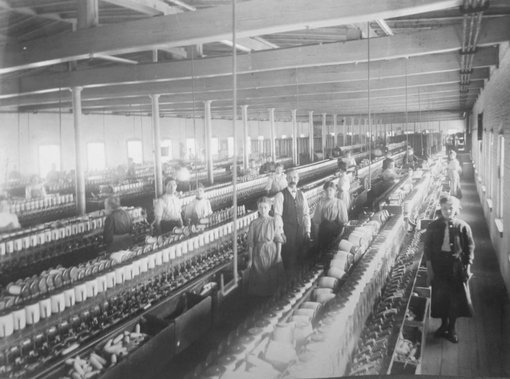 Ca. 1900 view of workers in the spinning room of the Hamilton Woolen Company in Amesbury. (Amesbury Public Library)