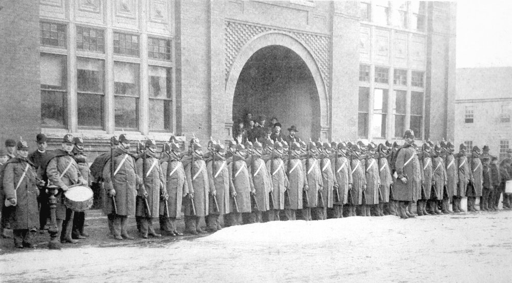 The Bartlett Rifles, Company B of the Eighth Regiment, Massachusetts Volunteer Militia, led by Captain E. W. M. Bailey, in front of the Amesbury Armory (now City Hall), 1889.