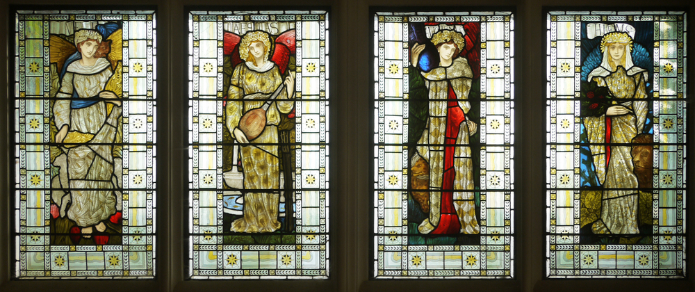 Windows representing the four seasons above the entrance doors, West Dean House.