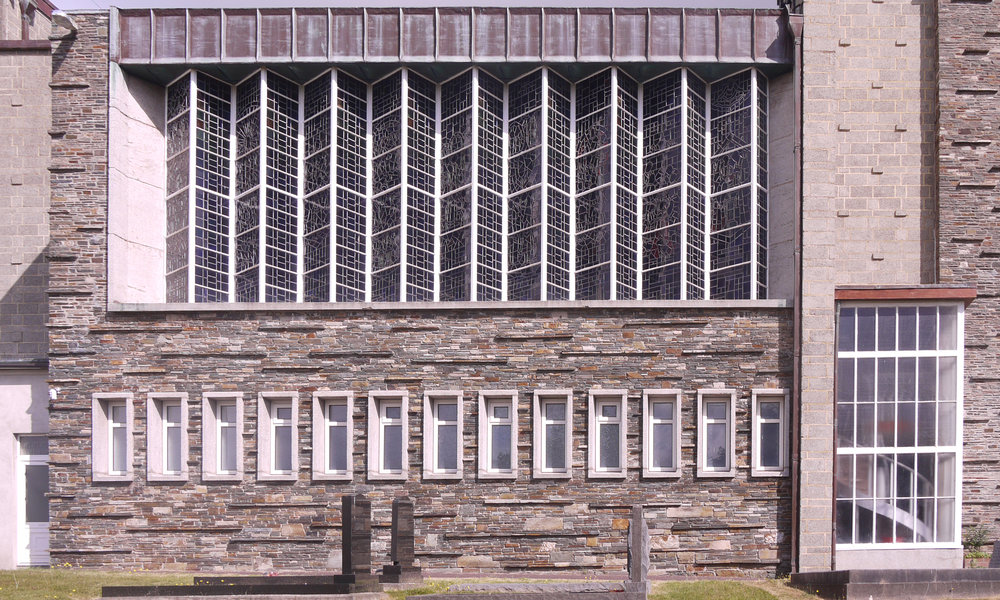 Row of windows on the south side of the church from the outside and the inside (above).