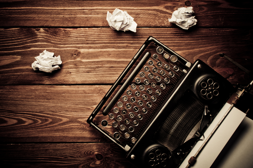 stock-photo-vintage-typewriter-and-a-blank-sheet-of-paper-retouching-retro-143642833.jpg
