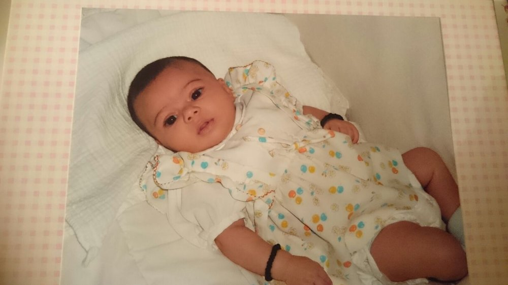 Cute alert! Tiny baby Maya wearing her mothers original vintage nylon dress.