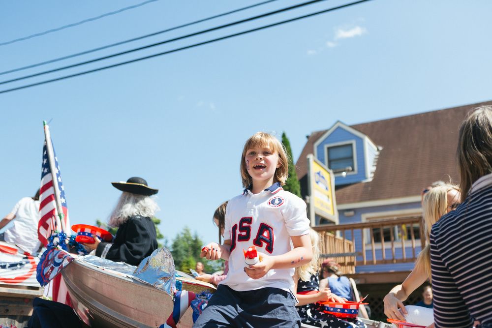 A boy wears patriotic colors and shouts to friends from a float in the Tannersville Parade.jpg