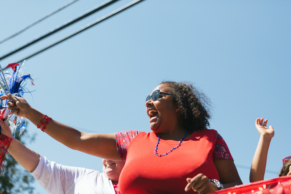 A woman excitedly cheers for a friend at the parade in Tannersville.jpg