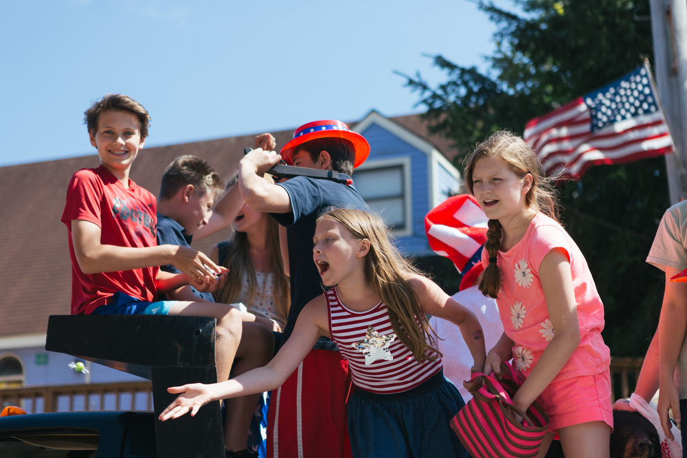 Children celebrate and throw candy from a float during the Tannersville Parade.jpg