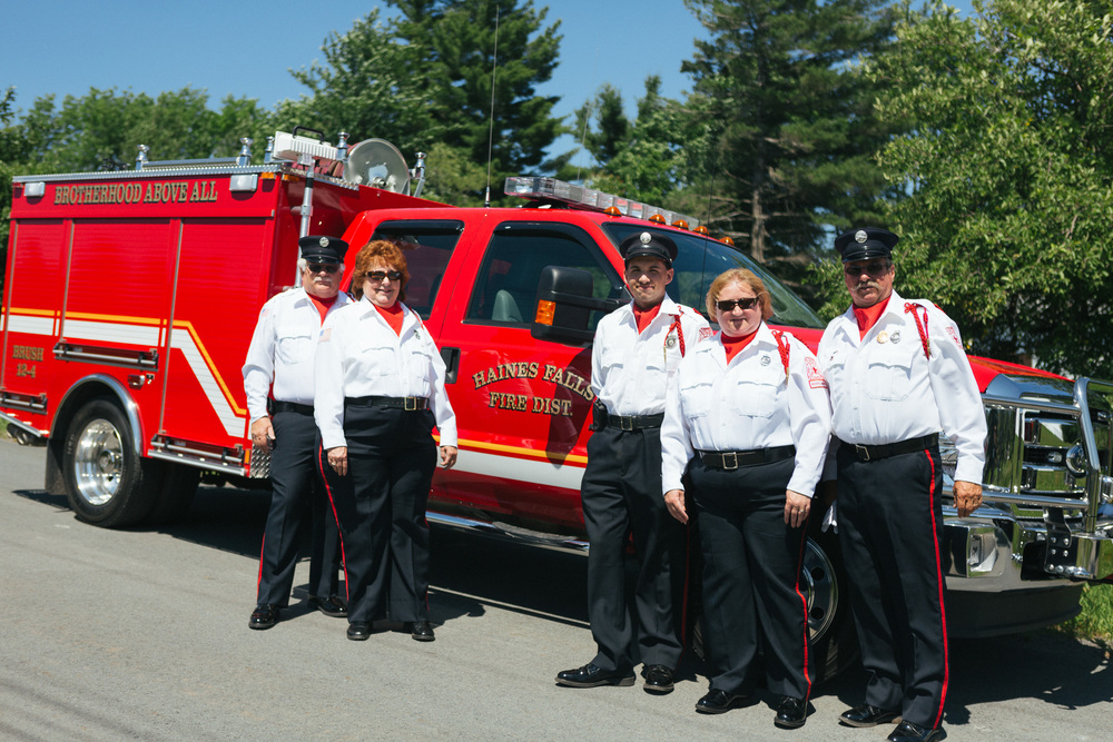 Haines Fall Fire Company stand proud next to one of their vehicles before the parade.jpg