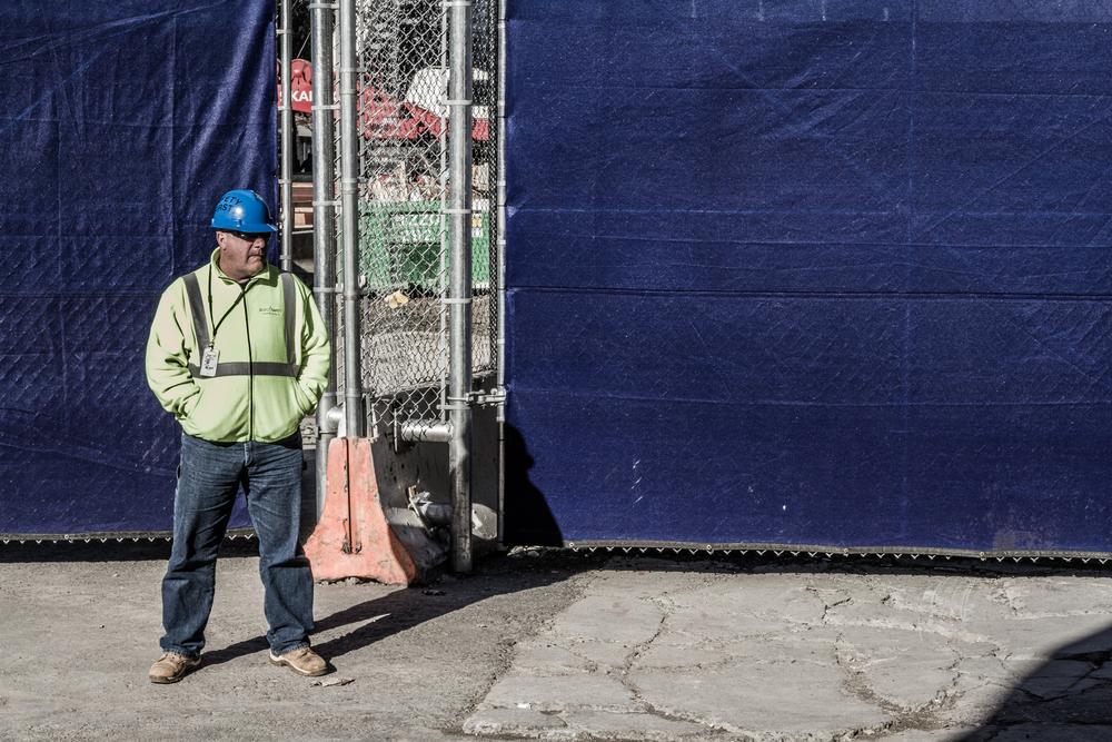 NYC-FiDi-ConstructionWorkerOutsideTradeCenter-11-125-11-1.jpg