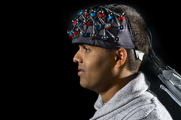 Danushka Bandara G'12 wears the functional near-infrared spectroscopy device.