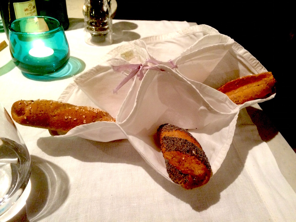 Bread served in a traditional folded and stitched napkin