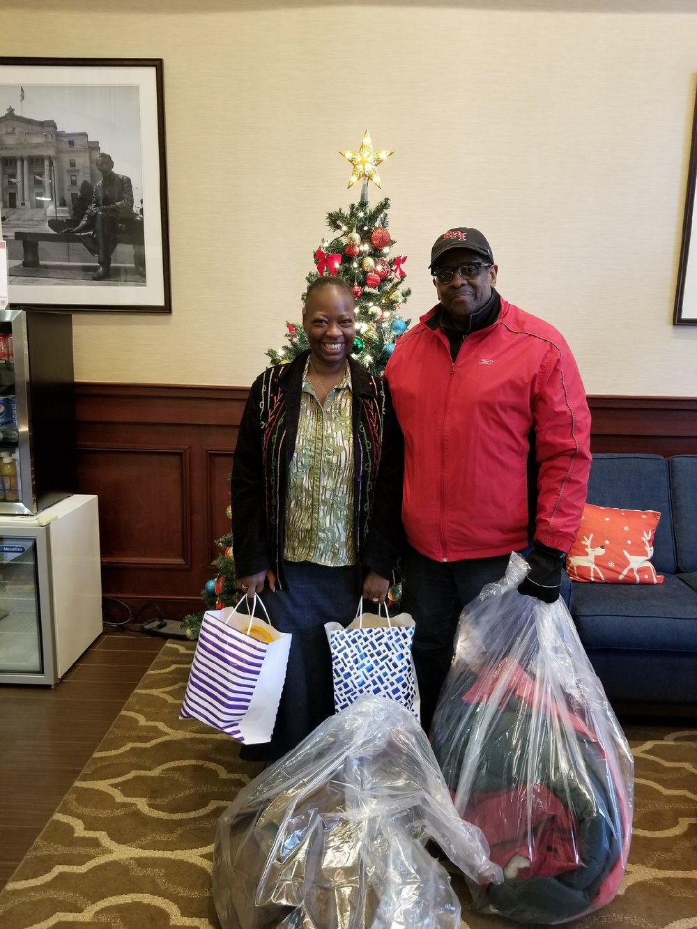 FARC delivered two bags of winter coats to a family at the Comfort Suite Inn in Newark. The family was displaced by a fire two days before Christmas  . The gift bags in this picture was donated by Friends of FARC, Ellen and Wendell Maddrey.
