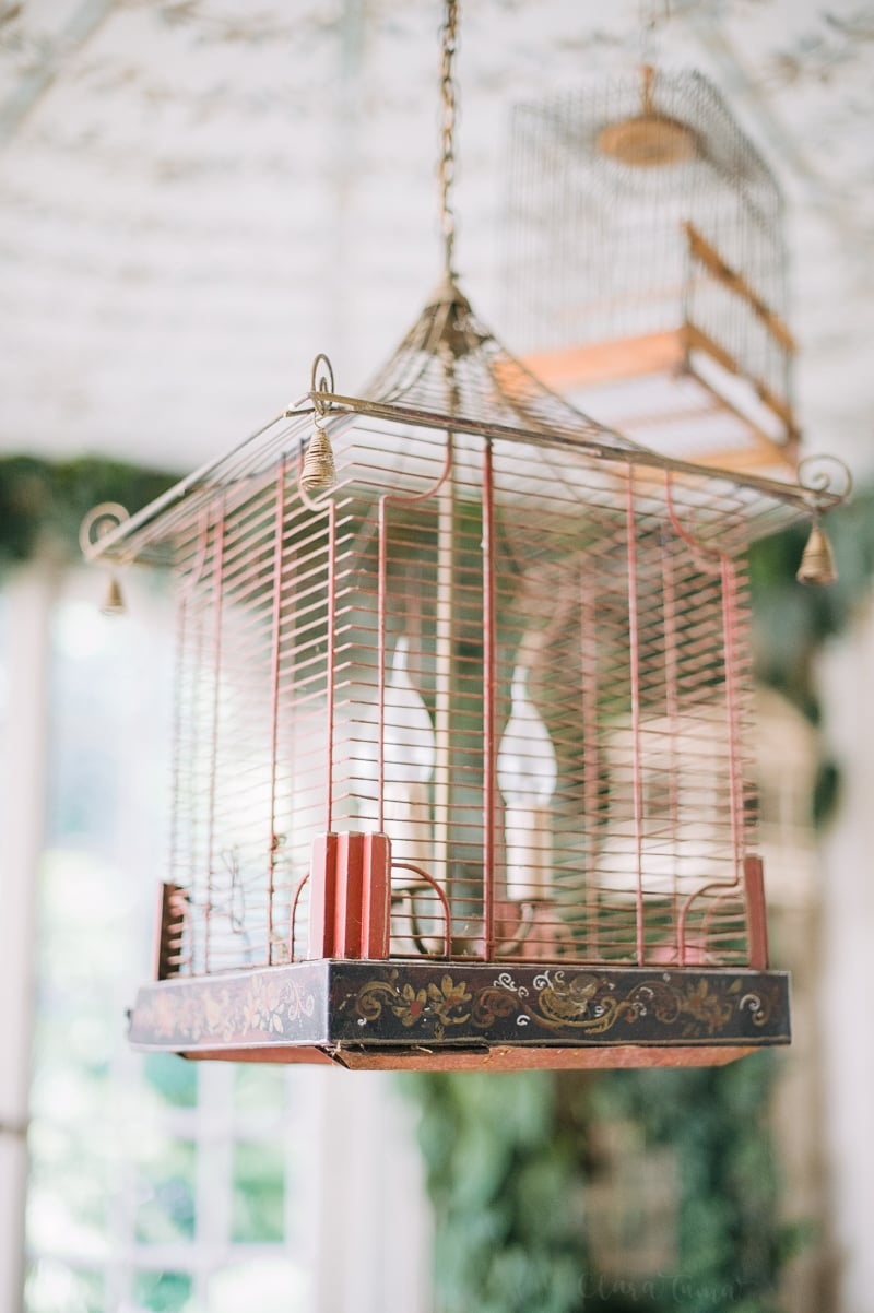 Caroline Scheufele's home. One of the birdcages hanging in the covered outdoor room (part of terrasse).