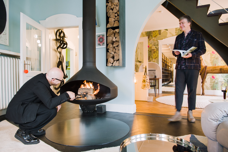 Peter Ippolito (left) and Stefan Gabel (right) by the fireplace in the living room in their home in Stuttgart.   