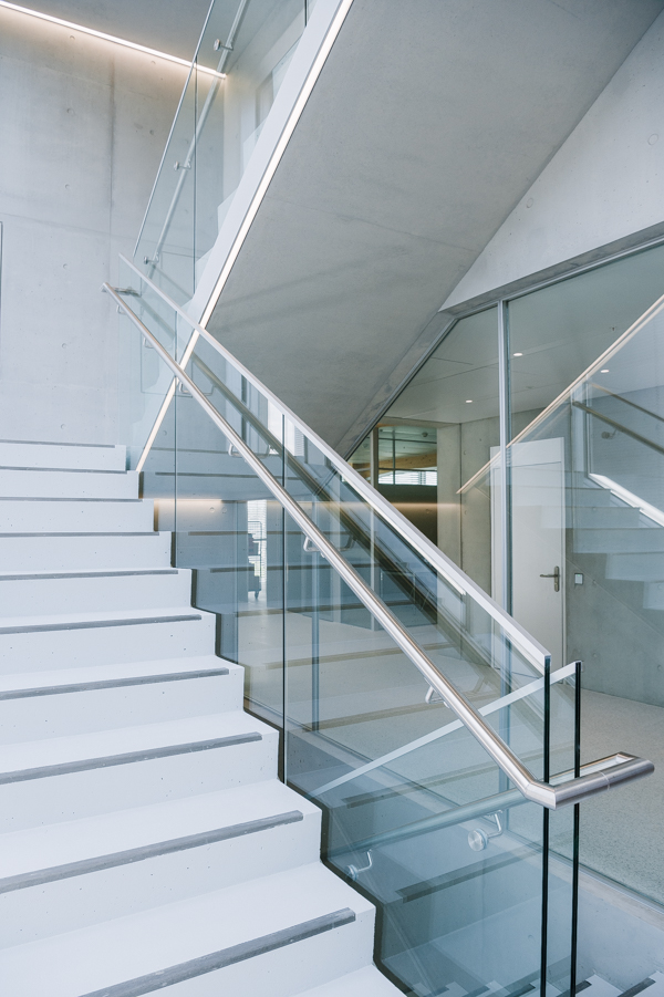 The light filled staircase in the new Omega production building - lots of concrete, lots of glass.