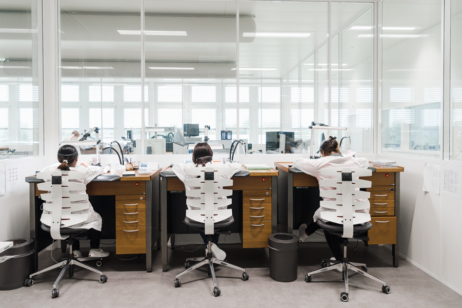 This is the quality control department. Technicians inspect every watch by hand.