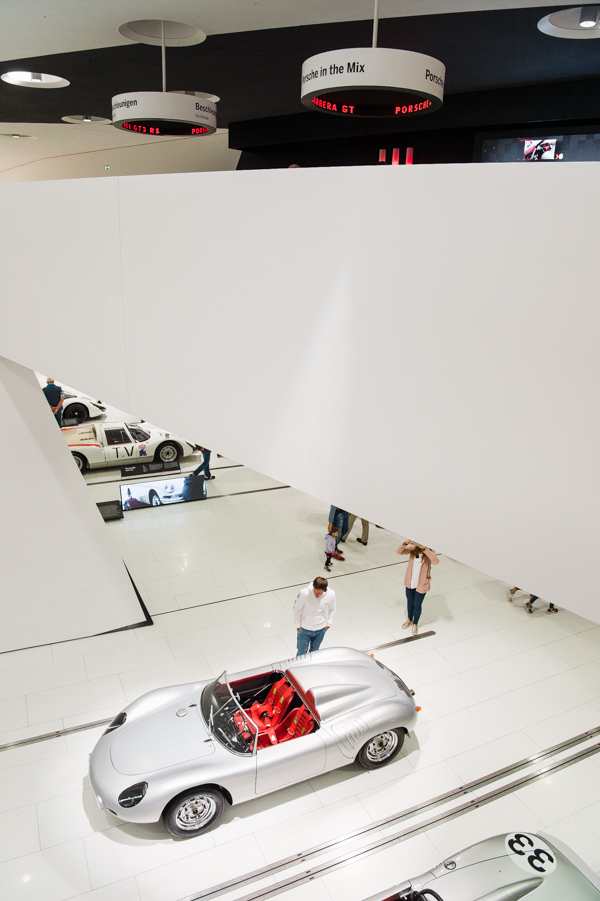 An inside view of the Porche Museum, looking from the upper level down on the mail level.