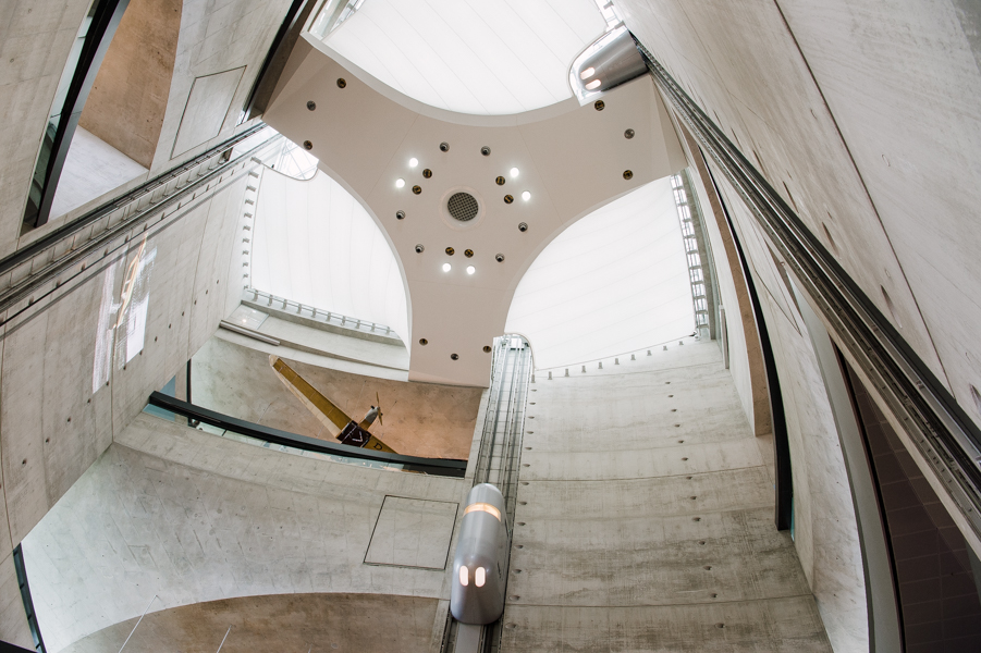 "Interior architecture of the Mercedes-Benz Museum. The ""capsule"" in the middle is one of the elevators bringing visitors to the top floor to begin the history tour of the brand."