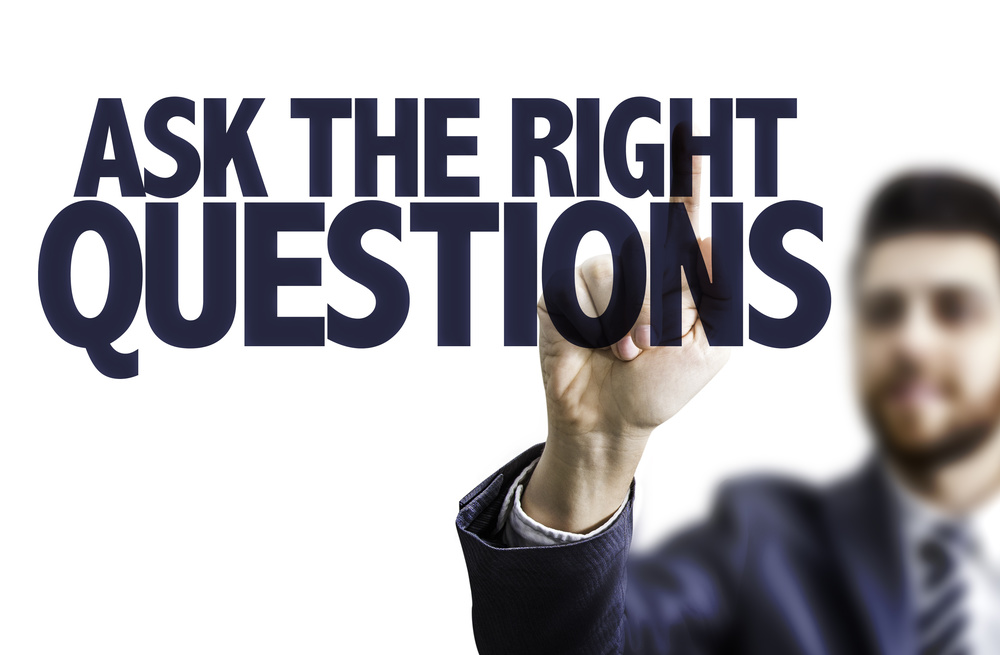 Business man pointing the text: Ask The Right Questions