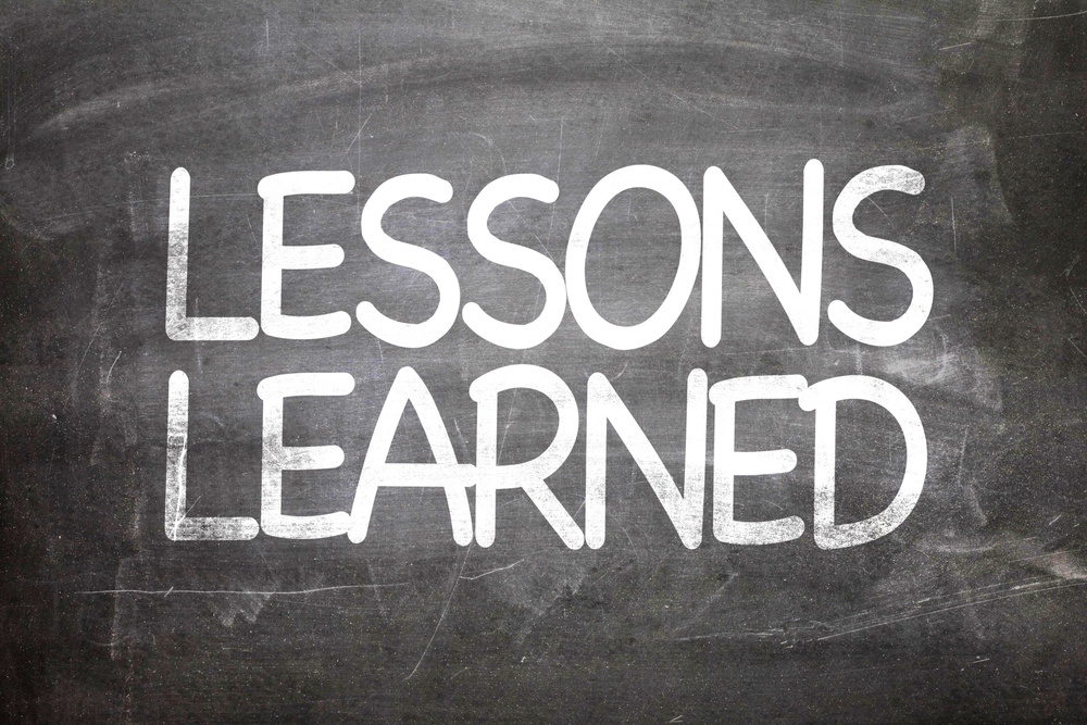 Lessons Learned written on a chalkboard