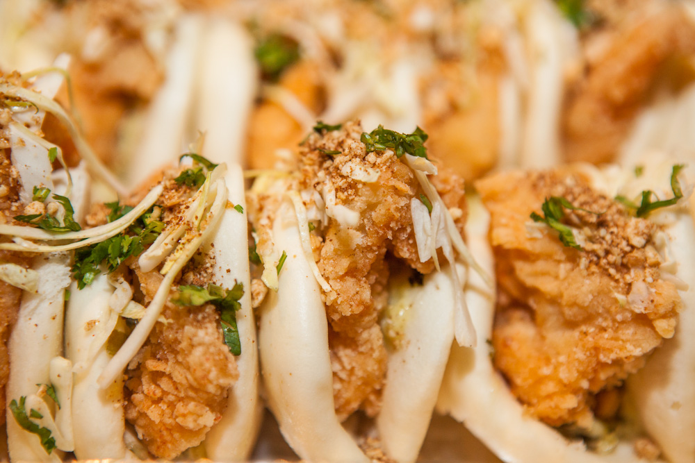 Fried Fish Filet Bao - Fried fish filet served with Haus Tartar Sauce, lemon cabbage slaw, fried garlic, crushed peanuts, Taiwanese red sugar, and cilantro. $105