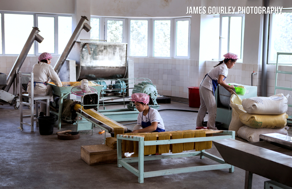 A food production line in Chongjin. None of the rooms were air conditioned, so had open windows, probably compromising cleanliness