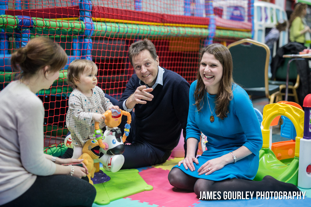 01/04/2015. Bishopbriggs, UK. Deputy Prime Minister and leader of the Liberal Democrats Nick Clegg and Jo Swinson talk with Elena (left) and Sophia O'Driscoll (centre left) at PlayTown in Bishopbriggs, East Dunbartonshire talking about shared parental leave. Photo by James Gourley/Liberal Democrats