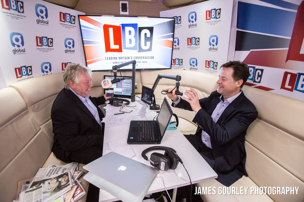The Deputy Prime Minister and Leader of the Liberal Democrats Nick Clegg with Nick Ferrari (left) on board the LBC battle bus in Leeds' Millennium Square for his weekly phone in show.