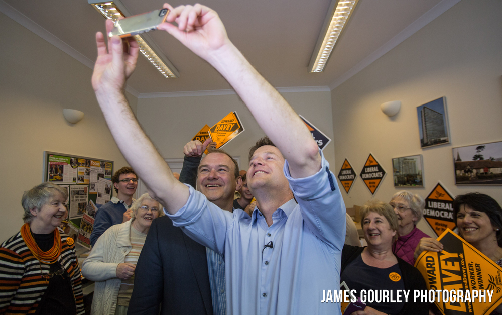 The Deputy Prime Minister and Leader of the Liberal Democrats Nick Clegg taking selfies with the Lib Dem PPC for Kingston and Surbiton, Ed Davey (left) after a rally inside Ed Davey's constituency office in Kingston Upon Thames today (04/05)