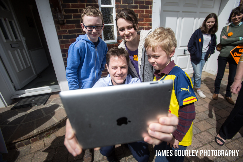 The Deputy Prime Minister and Leader of the Liberal Democrats Nick Clegg taking a selfie with children after hosting a campaign rally in Sutton with the Lib Dem PPC for Sutton & Cheam Paul Burstow (04/05)