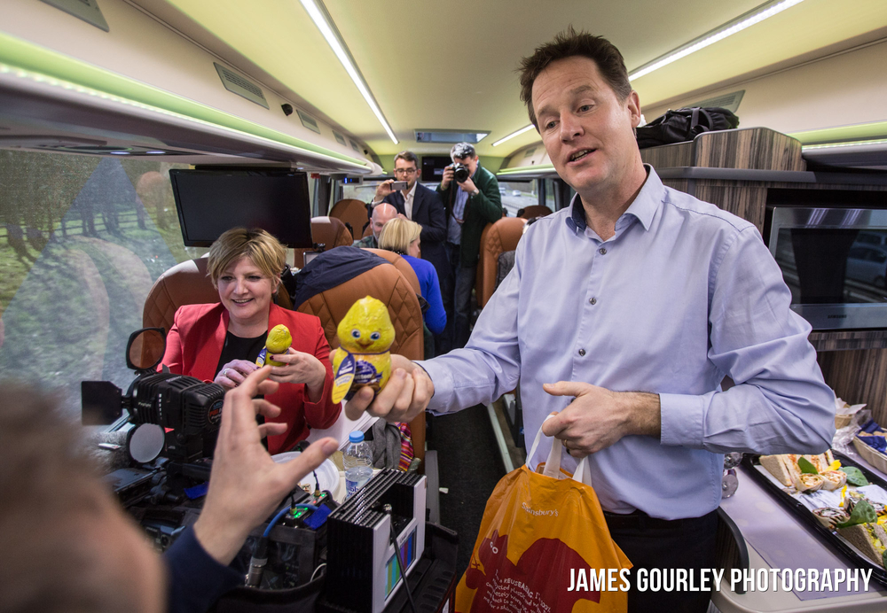 06/04/2015. Surbiton, UK. The Deputy Prime Minister and Leader of the Liberal Democrats Nick Clegg handing out easter chocolate to journalists on the Lib Dem battle bus. Photo by James Gourley/Liberal Democrats