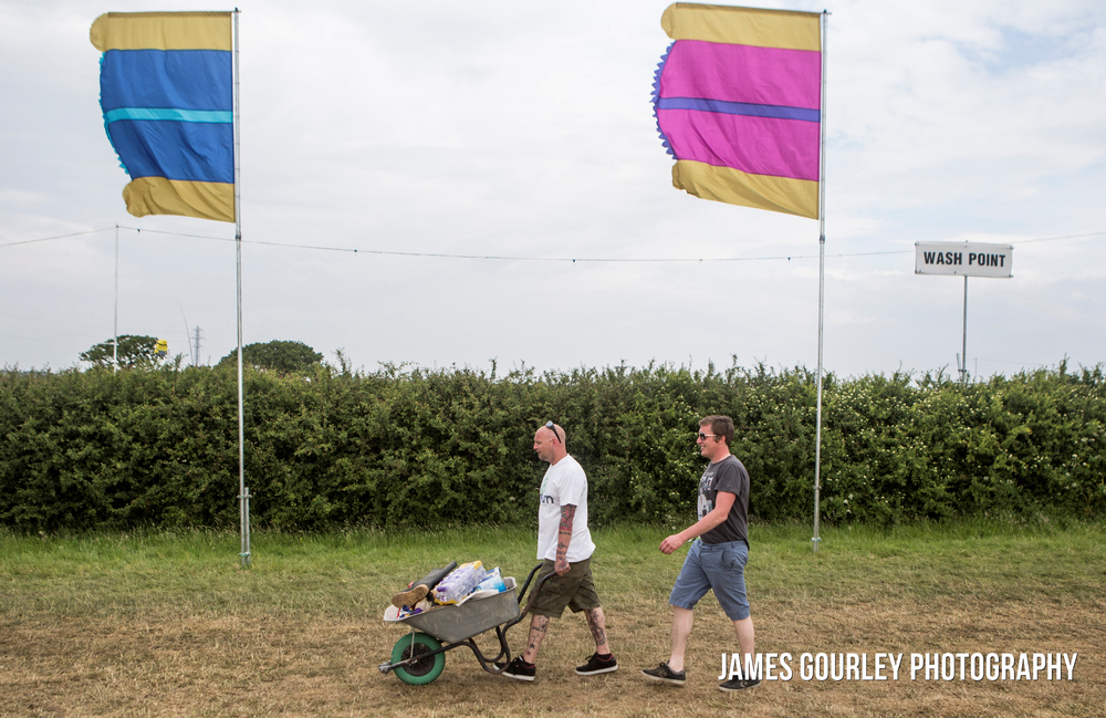 Festival goers arriving on the site of the Isle of Wight Festival 2015 on day two. The festival features headline performances from the Prodigy, Blur and Fleetwood Mac.