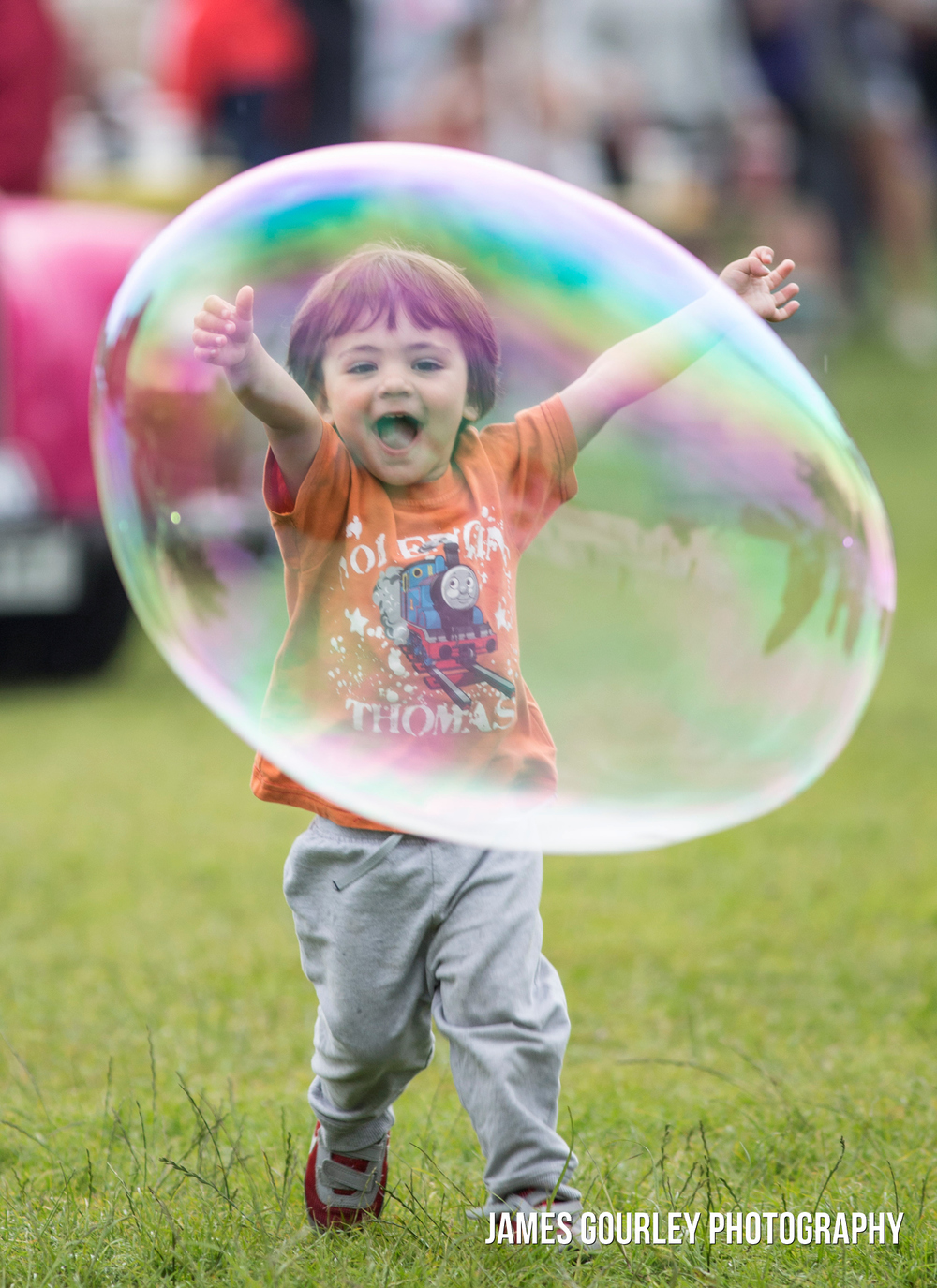 A child plays with bubbles at the Isle of Wight Festival 2015.