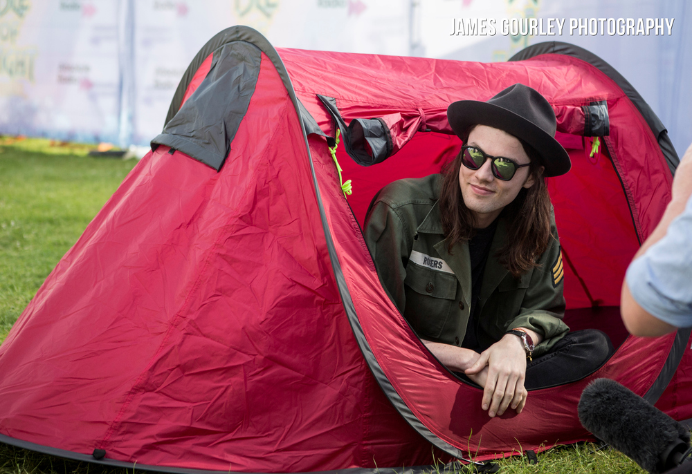 James Bay being interviewed in a pop up tent at the Isle of Wight Festival 2015