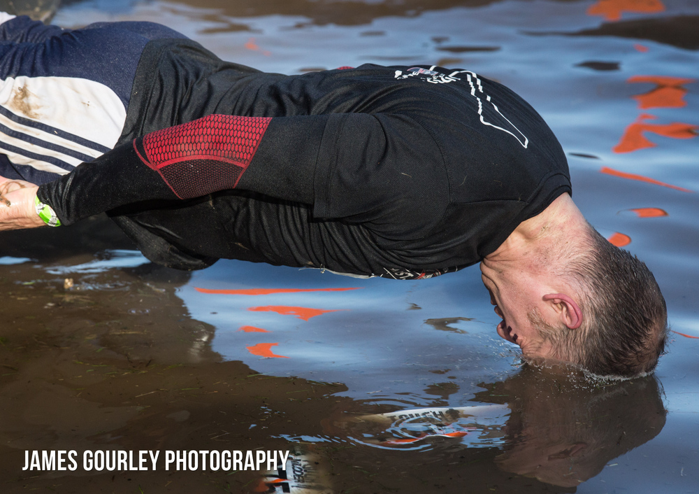 A participant dives into water