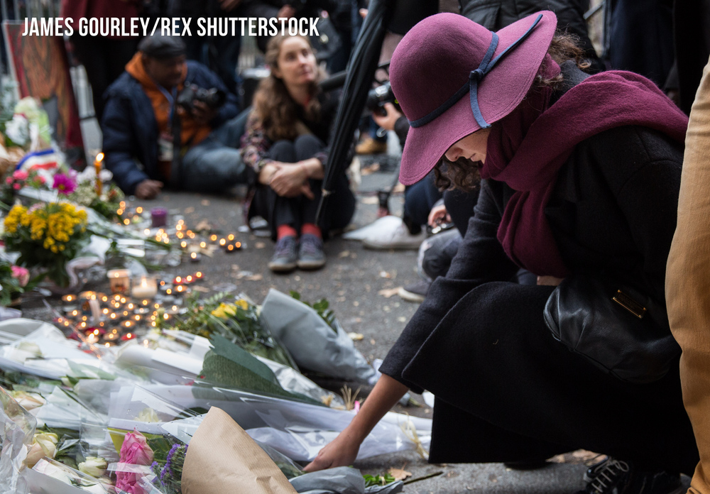 People mourning outside the Bataclan Café