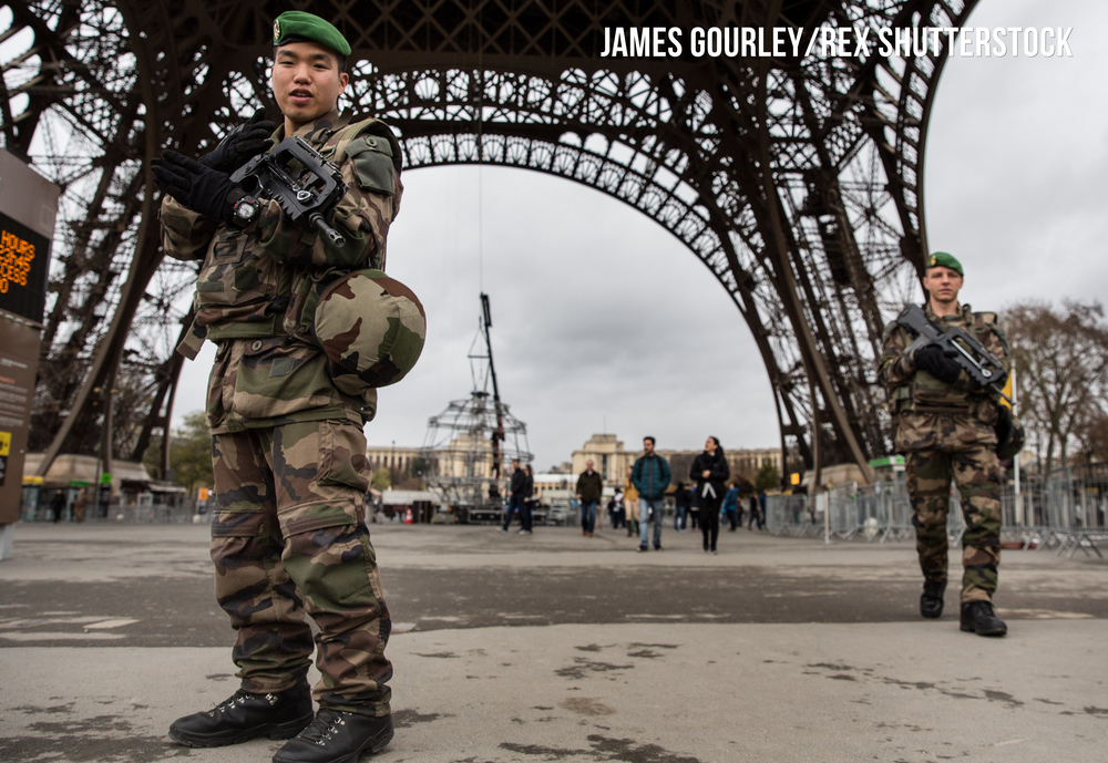 Armed soldiers on patrol at the Eiffel Tower
