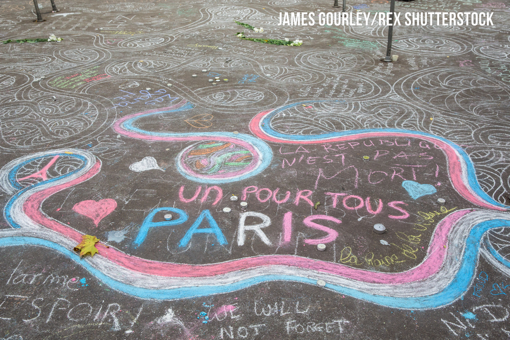 Chalk messages on the ground near the Bataclan Caf�